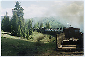Train with 6 tank cars, box car 3014 and 2 engines below Cumbres Pass.<br /> C&amp;TS  below Cumbres Pass, CO