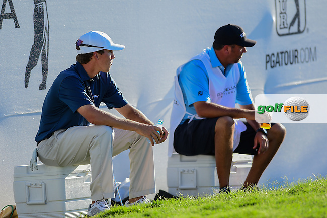Kramer Hickock (USA) and his caddie sit on coolers near the 9th green while Tom Hoge (USA) takes his drop during the round 2 of the Dean &amp; Deluca Invitational,  Colonial Country Club, Ft. Worth, Texas, USA. 5/27/2016.<br /> Picture: Golffile | Ken Murray<br /> <br /> <br /> All photo usage must carry mandatory copyright credit (&copy; Golffile | Ken Murray)