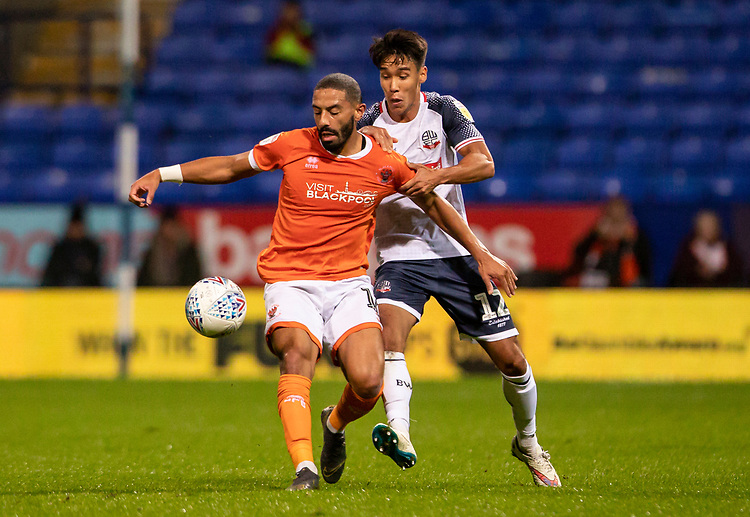 Bolton Wanderers' Adam Chicksen (right) competing with Blackpool's Liam Feeney <br /> <br /> Photographer Andrew Kearns/CameraSport<br /> <br /> The EFL Sky Bet League One - Bolton Wanderers v Blackpool - Monday 7th October 2019 - University of Bolton Stadium - Bolton<br /> <br /> World Copyright © 2019 CameraSport. All rights reserved. 43 Linden Ave. Countesthorpe. Leicester. England. LE8 5PG - Tel: +44 (0) 116 277 4147 - admin@camerasport.com - www.camerasport.com