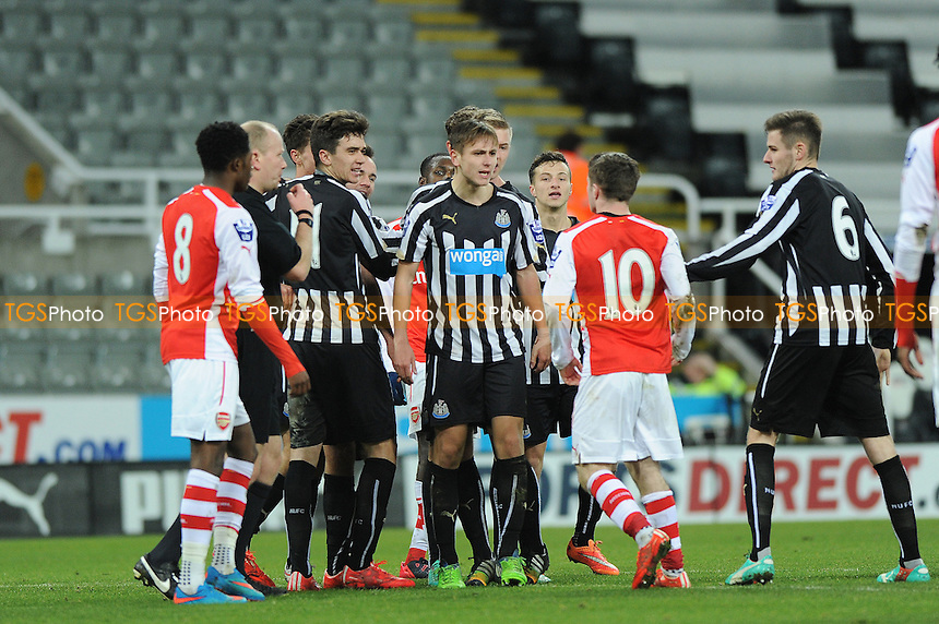 Newcastle United players clash with Daniel Crowley of Arsenal after he reacts to the equaliser scored by Dan Barlaser - Newcastle United Under-21 vs Arsenal Under-21 - Barclays Under-21 Premier League Football at St James Park, Newcastle United FC - 09/02/15 - MANDATORY CREDIT: Steven White/TGSPHOTO - Self billing applies where appropriate - contact@tgsphoto.co.uk - NO UNPAID USE