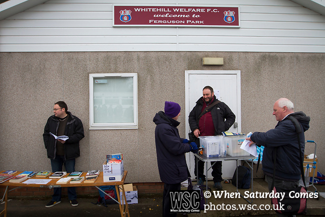 Whitehill Welfare 3 Gala Fairydean Rovers 0, 12/03/2016. Ferguson Park, Rosewell, Scottish Lowland League. GroundhopUK organiser Laurance Reade (second right) welcoming 'groundhoppers' to Ferguson Park, Rosewell, as Whitehill Welfare take on Gala Fairydean Rovers in a Scottish Lowland League fixture, which the home team won 3-0. The match was one of six arranged by the league and GroundhopUK over the weekend to accommodate groundhoppers, fans who attempt to visit as many football venues as possible. Around 100 fans in two coaches from England participated in the 2016 Lowland League Groundhop and they were joined by other individuals from across the UK which helped boost crowds at the six featured matches. Photo by Colin McPherson.