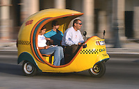 13 FEB 2003 - HAVANA, CUBA - One of Cubas cocotaxis carries fares through Havanas streets (PHOTO (C) NIGEL FARROW)