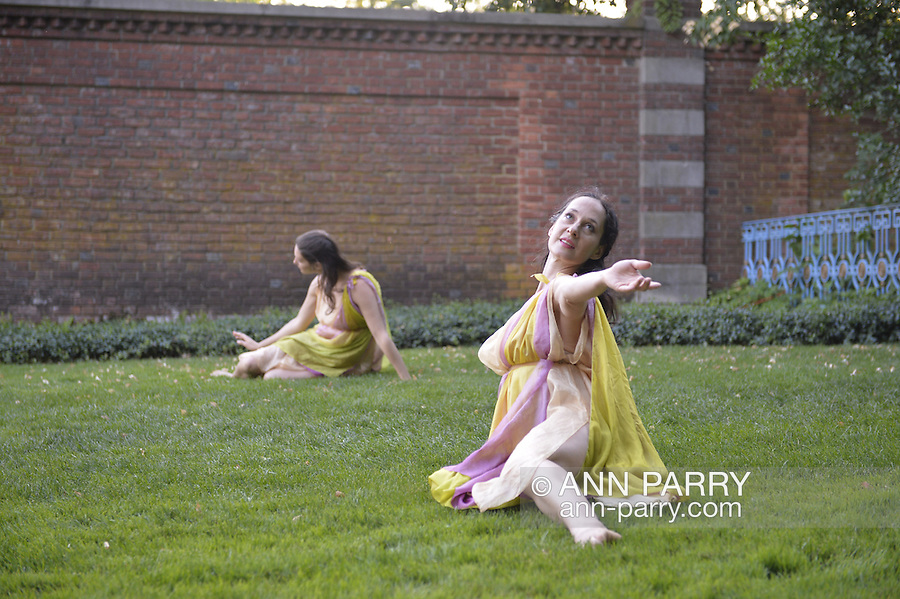 Old Westbury, New York, U.S. - June 21, 2014 - Lori Belilove & The Isadora Duncan Dance Company dances modern dance in Greek tunics throughout the gardens during the Midsummer Night event at the historic Long Island Gold Coast estate of Old Westbury Gardens on the first day of summer, the summer solstice.