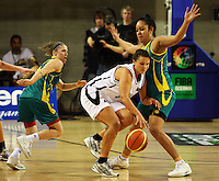 Ferns guard Susie Bates is marked by Natalie Hurst (left) and Eva Afeaki during the International women's basketball match between NZ Tall Ferns and Australian Opals at Te Rauparaha Stadium, Porirua, Wellington, New Zealand on Monday 31 August 2009. Photo: Dave Lintott / lintottphoto.co.nz
