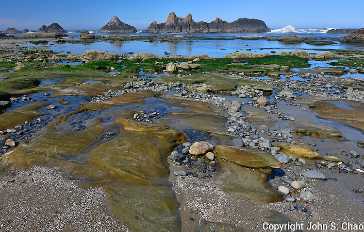 Seal Rock Beach's colorful layers of sedimentary rocks and sea stacks are exposed at low tide, Seal Rock, Oregon