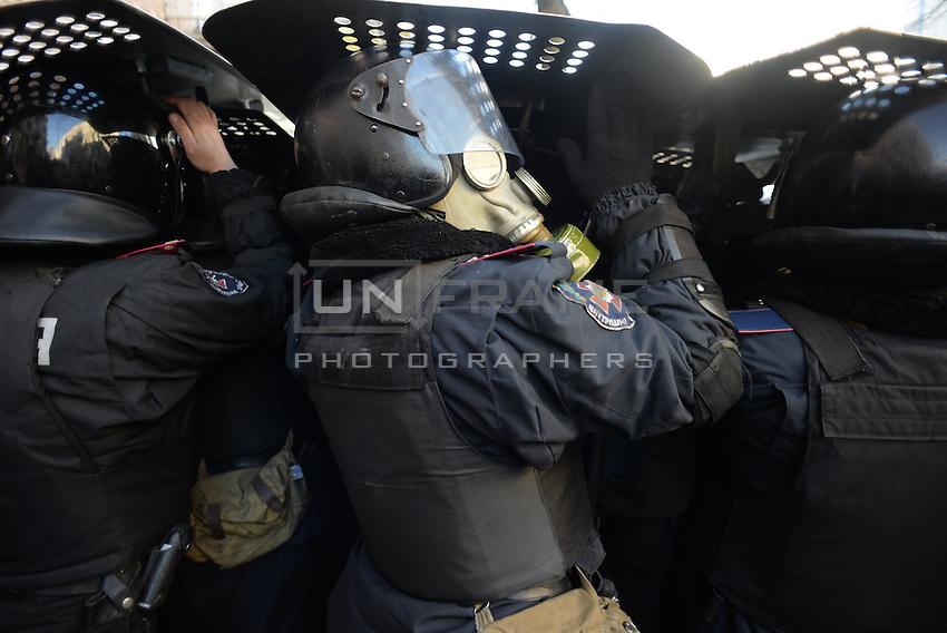 A riot policemen defend themselves under their shields. Kiev, Ukraine