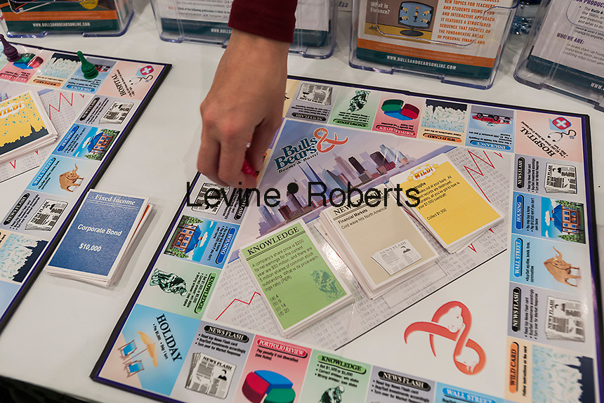 Bulls & Bears financial literacy board game at the 113th North American International Toy Fair in the Jacob Javits Convention center in New York on Sunday, February 14, 2016.  The game endeavors to teach financial literacy.  (© Richard B. Levine)