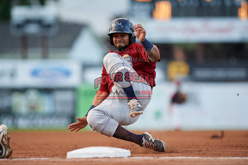 Mahoning Valley Scrappers catcher Jason Rodriguez (20) slides into third base during a game against the Batavia Muckdogs on August 18, 2017 at Dwyer Stadium in Batavia, New York.  Mahoning Valley defeated Batavia 8-2.  (Mike Janes/Four Seam Images)