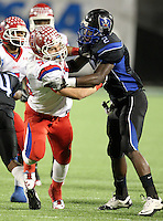 Manatee Hurricanes defensive lineman Blake Keller #55 pursues a play while being blocked by Joseph Jackson #2 during the first quarter of the Florida High School Athletic Association 7A Championship Game at Florida's Citrus Bowl on December 16, 2011 in Orlando, Florida.  The score at halftime is Manatee 17 - First Coast 0.  (Mike Janes/Four Seam Images)