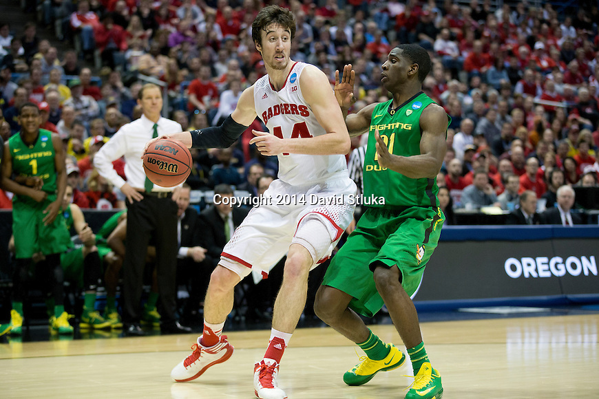 Wisconsin Badgers center Frank Kaminsky (44) handles the ball during the third-round game in the NCAA college basketball tournament against the Oregon Ducks Saturday, April 22, 2014 in Milwaukee. The Badgers won 85-77. (Photo by David Stluka)
