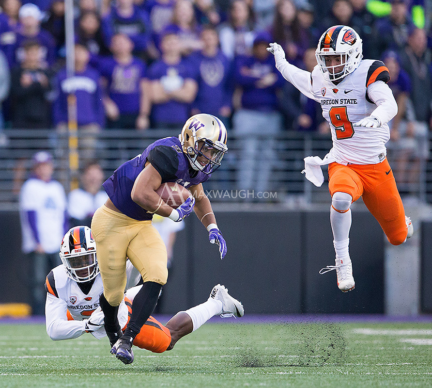 Everybody's flying as Myles Gaskin evades tacklers.