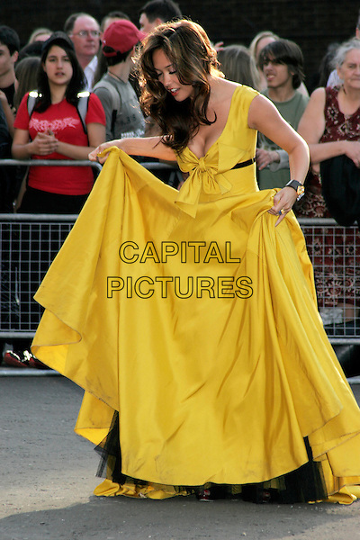 MYLEENE KLASS.Arrivals for the Classical Brit Awards 2008 held at the Royal Albert Hall, London, England, UK..May 8th, 2008.full length yellow dress bow holding skirt long looking down black chiffon sleeveless.CAP/AH.©Adam Houghton/Capital Pictures.