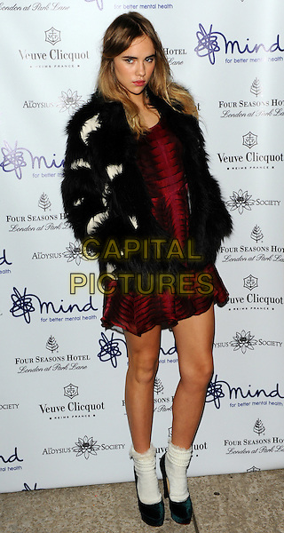 Suki Waterhouse.'Mindful' gala exhibition and gala dinner to raise funds for the Mind creative therapies fund, Imperial War Museum, London, England..September 21st, 2011.full length red dress black white fur jacket socks shoes hands in pockets .CAP/CJ.©Chris Joseph/Capital Pictures.