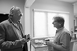June 21, 2017. Garden City, New York, USA. Bob and Marc chat in kitchen area.