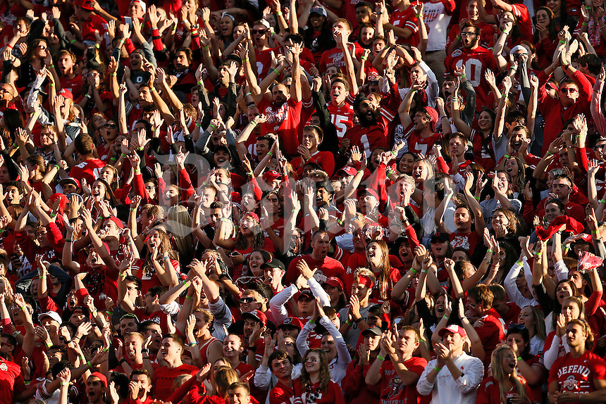 Ohio State students celebrate a touchdown after safety Vonn Bell (11) recovered a fumble in the end zone during the fourth quarter of the NCAA football game against the Hawaii Warriors at Ohio Stadium in Columbus on Sept. 12, 2015. (Adam Cairns / The Columbus Dispatch)