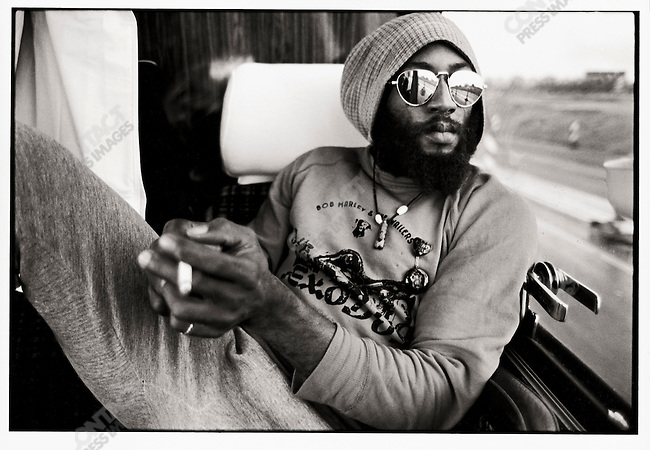 """Bob Marley and The Wailers on thier tour bus during their Exodus Tour in Europe. Pictured here, Road Manager Tony """"Gilly"""" GIlbert.  May 11, 1977."""