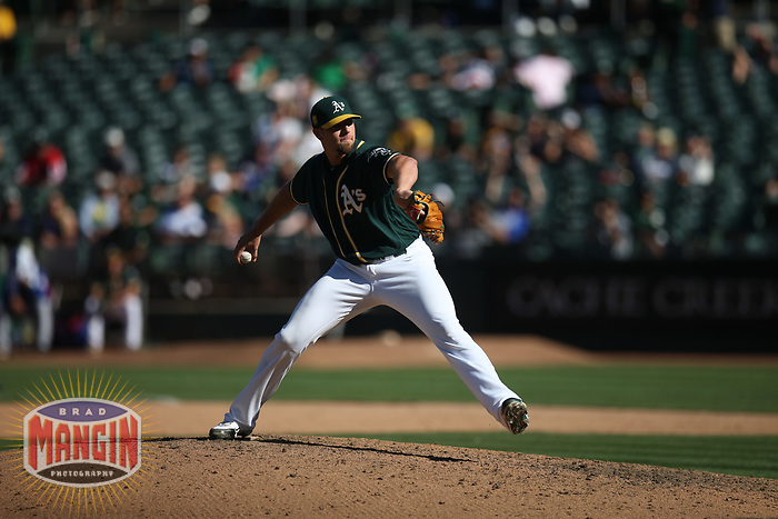 OAKLAND, CA - SEPTEMBER 8:  Blake Treinen #39 of the Oakland Athletics pitches against the Texas Rangers during the game at the Oakland Coliseum on Saturday, September 8, 2018 in Oakland, California. (Photo by Brad Mangin)