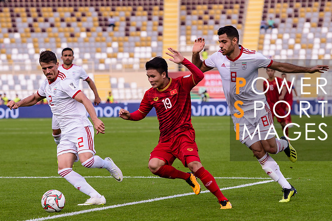Nguyen Quang Hai of Vietnam (C) fights for the ball with Morteza Pouraliganji (R) and Vorya Ghafouri of Iran (L) during the AFC Asian Cup UAE 2019 Group D match between Vietnam (VIE) and I.R. Iran (IRN) at Al Nahyan Stadium on 12 January 2019 in Abu Dhabi, United Arab Emirates. Photo by Marcio Rodrigo Machado / Power Sport Images