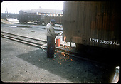 R.R. workman soldering on boxcar.<br /> D&amp;RGW  Alamosa, CO