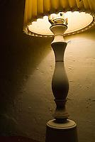 Table lamp light on peeling painted wall<br />