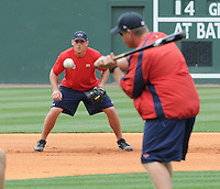 July 5, 2009: Manager Kevin Boles (19) of the Greenville Drive works with infielder Will Middlebrooks (11)) in a fielding drill prior a game against the Savannah Sand Gnats at Fluor Field at the West End in Greenville, S.C. Photo by: Tom Priddy/Four Seam Images