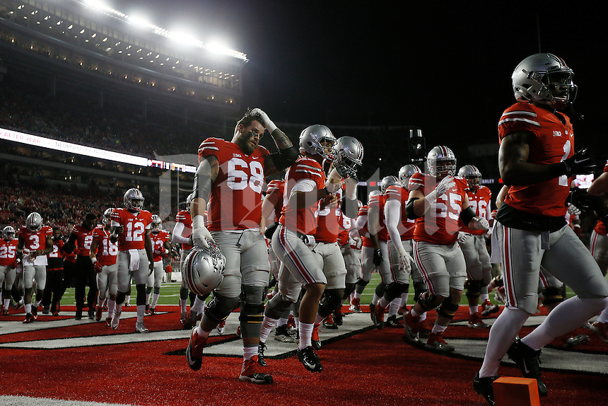 Ohio State Buckeyes offensive lineman Taylor Decker (68) takes off his helmet and heads to the locker room before the college football game between the Ohio State Buckeyes and the Minnesota Golden Gophers at Ohio Stadium in Columbus, Saturday night, November 7, 2015. The Ohio State Buckeyes defeated the Minnesota Golden Gophers 28 - 14. (The Columbus Dispatch / Eamon Queeney)