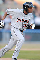 Delmarva Shorebirds left fielder Gregory Lorenzo #25 runs to first during opening night game against the Asheville Tourists at McCormick Field on April 3, 2014 in Asheville, North Carolina. The Tourists defeated the Shorebirds 8-3. (Tony Farlow/Four Seam Images)