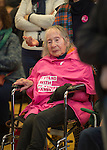 "Westbury, New York, USA. January 15, 2017. In wheelchair, PEARL BERGER, 97, of Amityville, who has breast cancer and Parkinson's Disease, has an ""I STAND WITH PLANNED PARENTHOOD"" pink shirt draped on her chest, at the ""Our First Stand"" Rally against Republicans repealing the Affordable Care Act, ACA, taking millions of people off health insurance, making massive cuts to Medicaid, and defunding Planned Parenthood."
