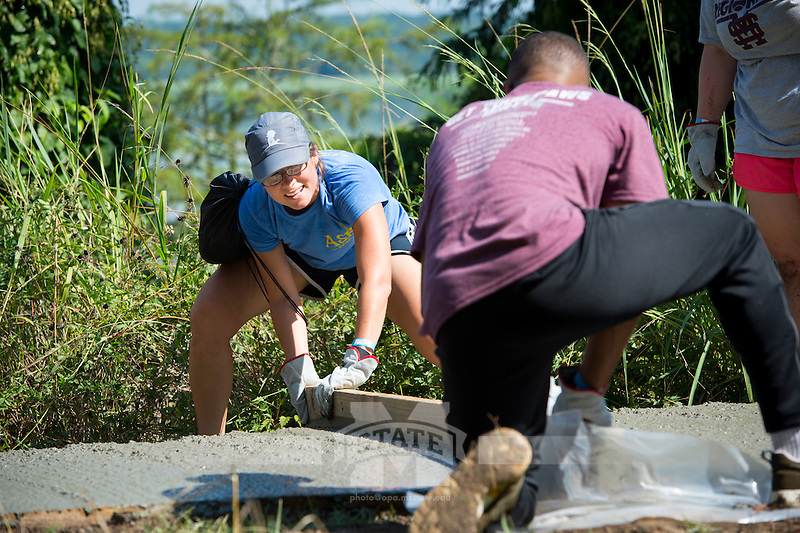 Service DAWGS Day: Pouring Concrete at the Noxubee Refuge.<br /> (photo by Russ Houston / &copy;  Mississippi State University)