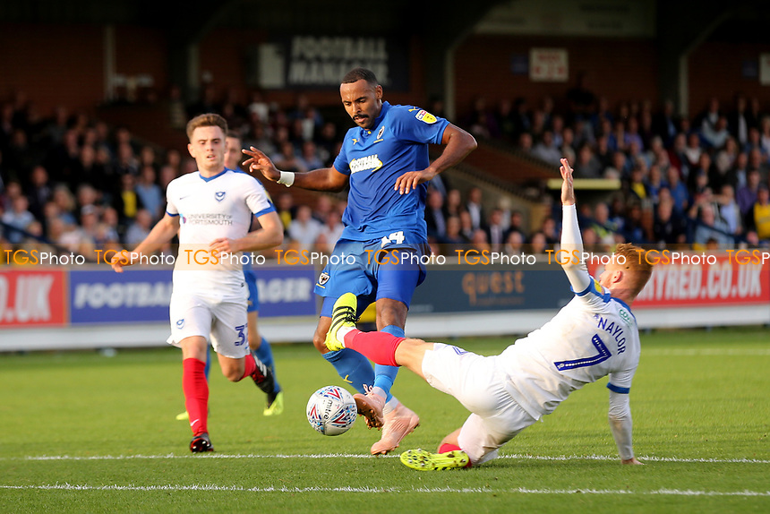 Liam Trotter of AFC Wimbledon evades a tackle from Portsmouth's Tom Naylor during AFC Wimbledon vs Portsmouth, Sky Bet EFL League 1 Football at the Cherry Red Records Stadium on 13th October 2018
