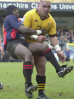 29/02/2004  -  Powergen  Cup - London Wasps v Pertemps Bees .Wasps's Trevor Leota [right ] carries Bees Luke Nabaro.   [Mandatory Credit, Peter Spurier/ Intersport Images].