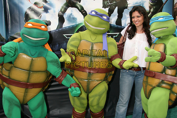 "TURTLES & ERICA MUNOZ.""TMNT"" (aka. ""Teenage Mutant Ninja Turtles"") Los Angeles Premiere at Grauman's Chinese Theatre, Hollywood, California, USA, 17 March 2007..half length turtle costume dressed-up.CAP/ADM/BP.©Byron Purvis/AdMedia/Capital Pictures."