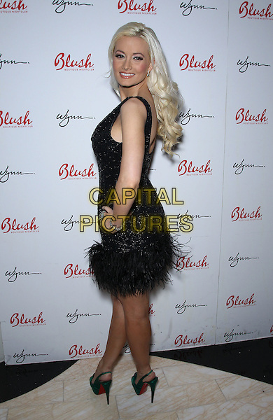 Holly Madison.Holly Madison hosts the 4th Anniversary of Blush Boutique Nightclub inside the Wynn , Las Vegas, NV., USA..September 3rd, 2011.full length black dress sleeveless sparkly  feather green shoes hand on hip side looking over shoulder .CAP/ADM/MJT.© MJT/AdMedia/Capital Pictures.