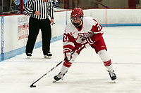 BOSTON, MA - JANUARY 04: Abbey Stanley #21 of Boston University brings the puck forward during a game between University of Maine and Boston University at Walter Brown Arena on January 04, 2020 in Boston, Massachusetts.
