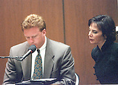 Prosecutor Marcia Clark, right, questions witness Jim Merrill of the Hertz Corporation, left, during the trial of former NFL star running back O.J. Simpson for the murder of his former wife, Nicole Brown Simpson and a friend of hers, restaurant waiter, Ron Goldman in Los Angeles County Superior Court in Los Angeles, California on July 13, 1995.<br /> Credit: Steve Grayson / Pool via CNP
