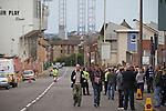 Fans walking up on Tannadice Street towards Dens Park stadium on the day Dundee FC take on visitors Greenock Morton in a Scottish League First Division match. The visitors won by one goal to nil watched by a crowd of 4,096. Dundee  stadium was situated on the same street as their city rival Dundee United, whose Tannadice Park ground was situated a few hundred yards away.