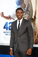 """LOS ANGELES - APR 9:  Chadwick Boseman arrives at the """"42"""" Premiere at the Chinese Theater on April 9, 2013 in Los Angeles, CA"""