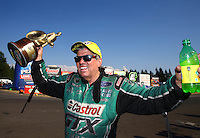 Aug. 3, 2014; Kent, WA, USA; NHRA funny car driver John Force celebrates after winning the Northwest Nationals at Pacific Raceways. Mandatory Credit: Mark J. Rebilas-USA TODAY Sports