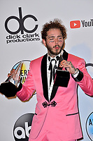 LOS ANGELES, CA. October 09, 2018: Post Malone at the 2018 American Music Awards at the Microsoft Theatre LA Live.<br /> Picture: Paul Smith/Featureflash