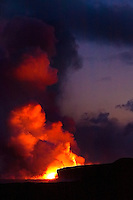Molten lava entering the Pacific Ocean at Kalapana, creating hydromagnetic explosions and massive steam clouds, Puna, Big Island.