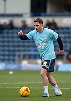 Matt Bloomfield of Wycombe Wanderers warms up in his NHS Sign for Life shirt during the Sky Bet League 2 match between Wycombe Wanderers and Bristol Rovers at Adams Park, High Wycombe, England on 27 February 2016. Photo by Andy Rowland.