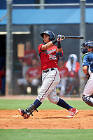 GCL Twins third baseman Roni Tapia (32) hits a home run during the first game of a doubleheader against the GCL Rays on July 18, 2017 at Charlotte Sports Park in Port Charlotte, Florida.  GCL Twins defeated the GCL Rays 11-5 in a continuation of a game that was suspended on July 17th at CenturyLink Sports Complex in Fort Myers, Florida due to inclement weather.  (Mike Janes/Four Seam Images)