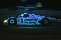 LE MANS, FRANCE - JUNE 11: The Joest Racing Porsche 962C 145 of Bob Wollek and Hans Stuck is driven en route to a third place finish in the 24 Hours of Le Mans at the Circuit de la Sarthe in Le Mans, France, on June 11, 1989.