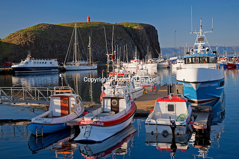 Fishing Boats at Dock in Quiet Harbor in Stykkisholmur in Iceland