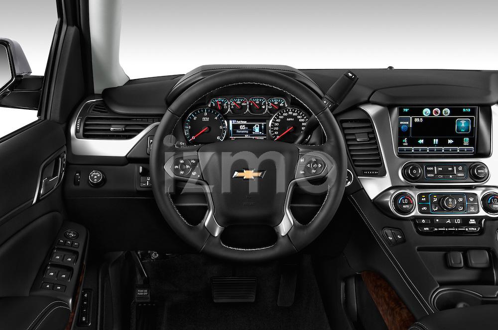 Steering wheel view of a 2015 Chevrolet Suburban 2WD 1500 LT 5 Door SUV