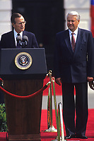 Washington DC., USA, June 17, 1992<br /> President George H.W. Bush with Russian President Boris  Nikoloyevich Yeltsin at remarks on the South lawn of the White House after 2 days of meetings during a summit in Washington DC. Credit: Mark Reinstein/MediaPunch