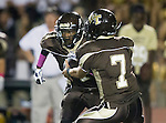 Torrance, CA 10/02/15 - Brylen Baucham (West #1) and Drake Peabody (West #7) in action during the Carson-West Torrance CIF varsity football game at West Torrance High School.  Carson defeated West Torrance 34-27.