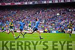 Barry John Keane Kerry in action against Michael Fitzsimons Dublin in the All Ireland Senior Football Final in Croke Park on the 20th September 2015.