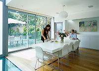 Home owners Bernard and Emma Shapero in their contemporary dining room