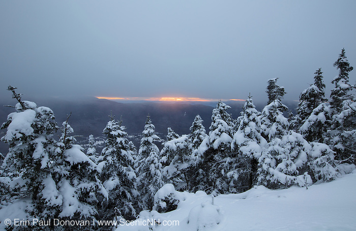 Stormy weather at sunrise from the small viewpoint on Mount Tecumseh in Waterville Valley, New Hampshire during winter months.